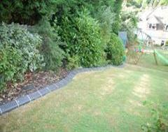 A Quality Edging on a Very Sloping Garden