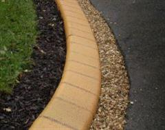 A Close Up of a Eurobrick Golden Sandstone Edge with Brown Mulch and 6mm Golden Gravel