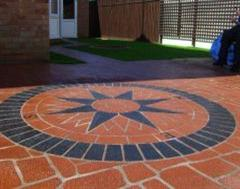 A Triple Quality Job of Eurobrick edging, Artificial Grass and Stencil concrete well Done