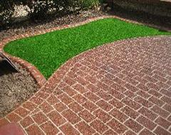 Another view of this fantastic Eurobrick edging, Artificial Grass and Stencil concrete installation