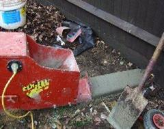 The Kwik Kerb machine at the start of a wood effect Eurostyle edging