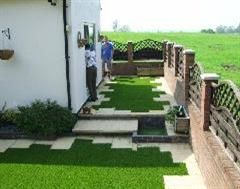 Kwik Kerb just finishing the two difficult Artificial Grass sections