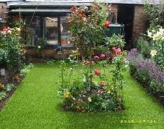 A beautiful rose garden with artificial grass