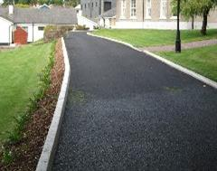 Commercial Kerbing with Drop Kerb on a Tarmac Drive